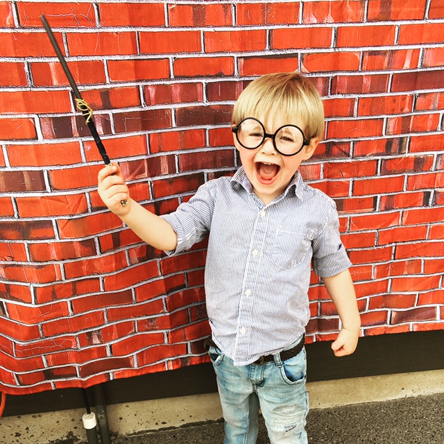 My Son, James, with the Ravenclaw Wand I Made at the Wand-Making Station. Photo Credit: J.H. Winter