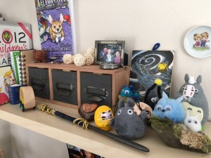 My Ravenclaw Wand Found a Happy Home on my Knick-Knack Shelf. Photo Credit: J.H. Winter